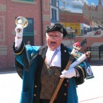Town cryer proclaiming his message